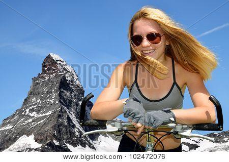 Portrait of a girl on bike in the Pennine Alps, Switzerland