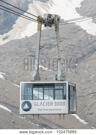 LES DIABLERETS SWIZTERLAND - JULY 22: Ski lift to area Glacier 3000 on July 22 2015. The area houses the world only suspension bridge between 2 mountain peaks. poster