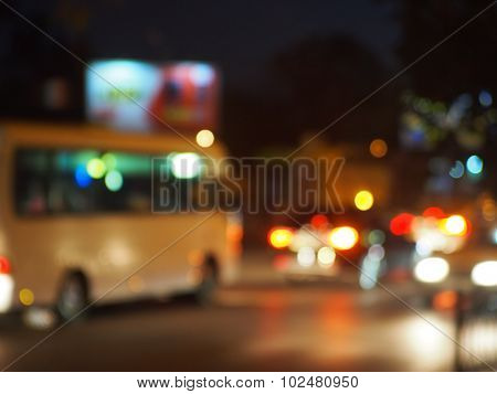 Abstract Night Scene With Bus And Headlights