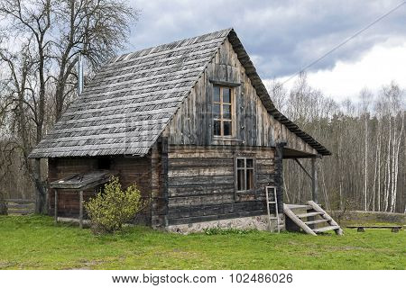 Lonely Log Cabin Surrounded By Rural Landscape