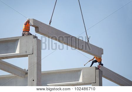 Height Workers Placing Truss On Building Skeleton
