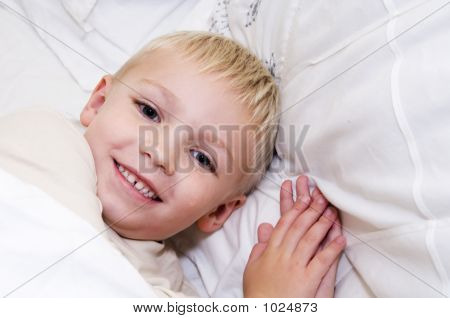 Boy In Bed Smiling