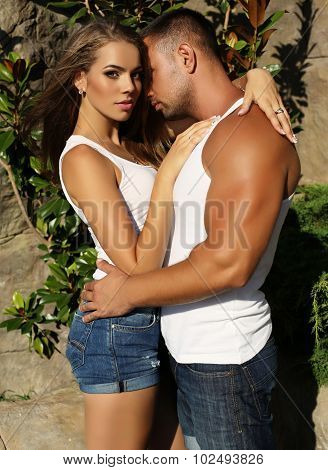 Gorgeous Woman And Handsome Man Embracing In Garden