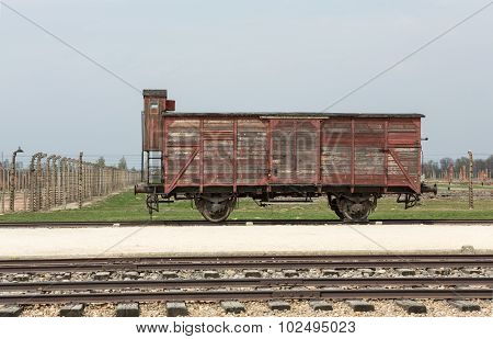 OSWIECIM, POLAND - APRIL 16 2015: Deportation wagon at Auschwitz Birkenau at Auschwitz Birkenau concentration camp Poland
