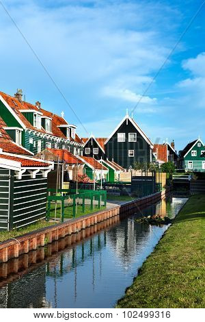 Reflection of a house in a canal of Marken