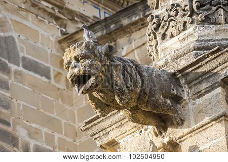 Gargoyle Protruding From The Facade Of A Cathedral