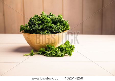Fresh kale in a bowl on the table