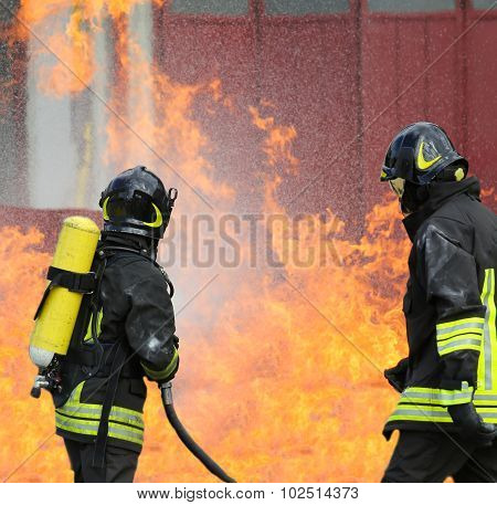 Firefighters With Oxygen Bottles Off The Fire During A Training Exercise