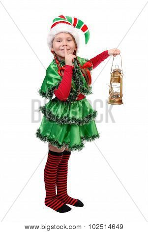 Girl In Suit Of Christmas Elf With Oil Lamp.
