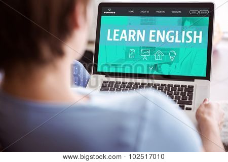 Pregnant woman using her laptop against learn english interface