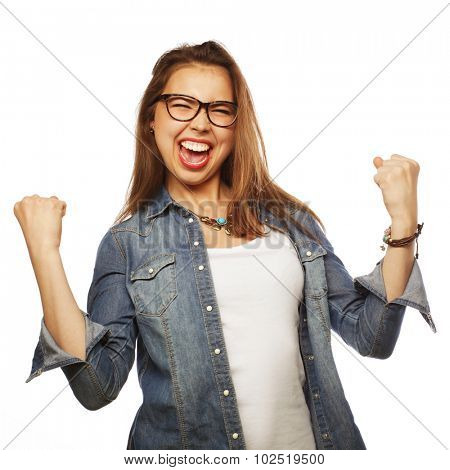 Portrait of happy excited woman celebrating her success.