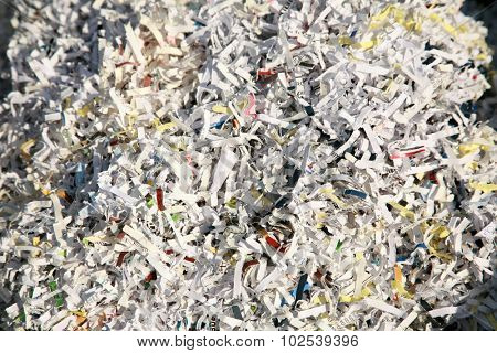Confetti Shredded paper in a recycle trash can. The best way to keep safe from Identity Fraud is to confetti shred your important discarded documents. ID fraud is a rising form of theft world wide