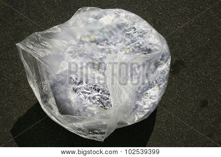 Confetti Shredded paper in a trash bag. The best way to keep safe from Identity Fraud is to confetti shred your important discarded documents. ID fraud is a rising form of theft world wide
