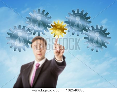 Manager Picking A Female Worker In A Gear Train