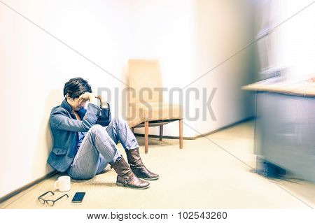 Depressed Hipster Business Woman Sitting On The Floor With Headache - Failure And Breakdown Concept