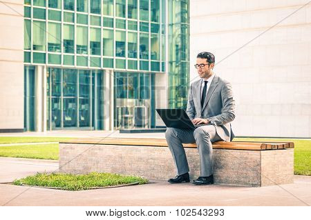 Young Hipster Business Man Sitting With Laptop At Business Center - Modern Concept Of Technology