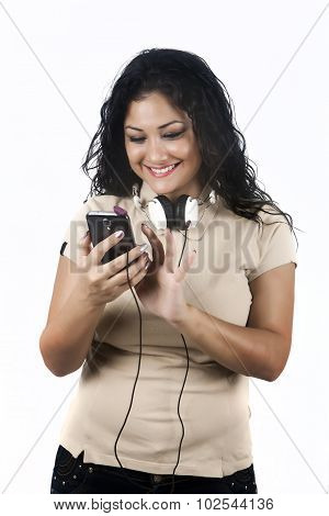 Young woman listening to music with mobile