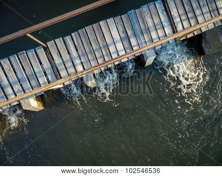 aerial view of river a diversion dam with a footbridge - Cache la Poudre RIver in northern Colorado