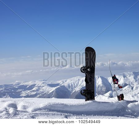 Two Snowboards In Snow Near Off-piste Slope In Sun Day