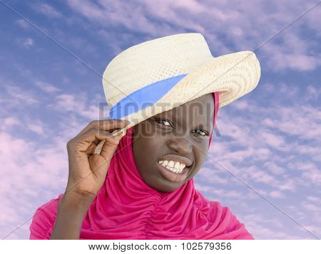Muslim girl wearing a straw hat at dawn, ten years old