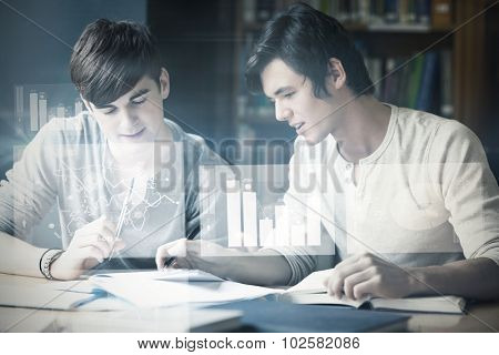 Digitally generated image of pie chart and bar graph against handsome student working on an essay