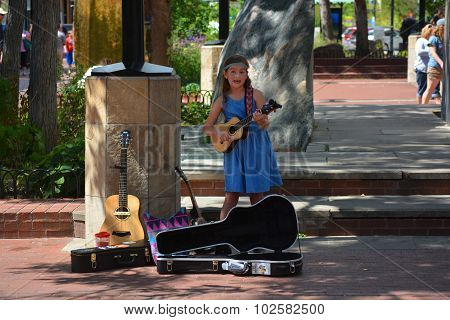 Young Girl Busking Playing Guitar