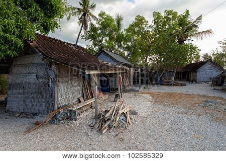 poor huts of the natives traditional indonesian poor house - shack on beach Nusa Penida Island Toyapakeh. Bali. poster
