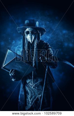 Black-and-white portrait of a terrible plague doctor with a scythe. Medieval Europe. Halloween.