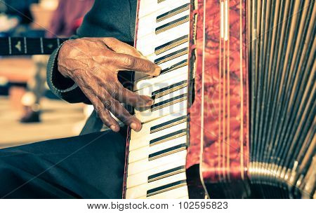 African Musician Hand Plays Fisarmonica - Street Artist Performing Traditional Songs With Accordion