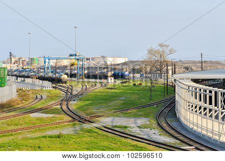 Railroad With Railcars In The Harbor Of Genoa