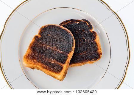 toast was burned during toasting. burnt toast at breakfast.