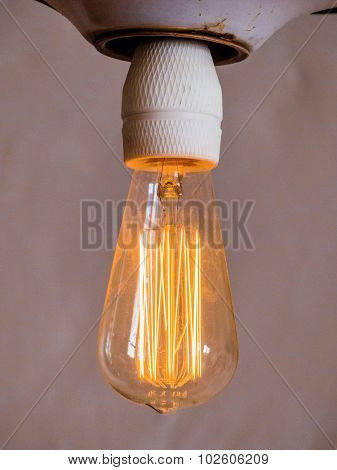 energy saving lamp, symbol photo for energy conservation, ecology, environmental protection. filament a glühbrine