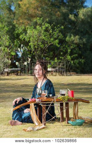 Polytheist Woman At Altar