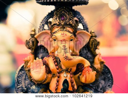 Yello Ganesh Elephant God in Hindusim mythology in rich king pose with multi-hands emperor crown and axe poster