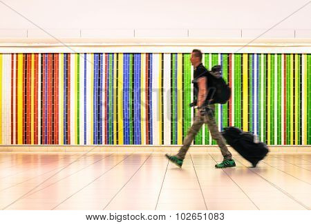 Man Walking At International Airport With Suitcase And Backpack - Alternative Travel Lifestyle