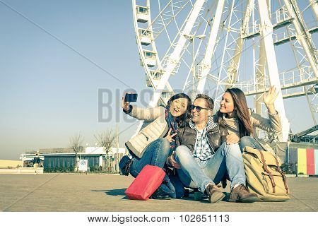 Young Hipster People Taking A Selfie At Luna Park With Ferris Wheel - Concept Of Friendship And Fun