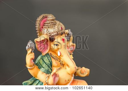 Yellow Ganesh (ganapati- Elephant God) In Hindusim Mythology Closeup Hold The Weapons Maze And Axe P