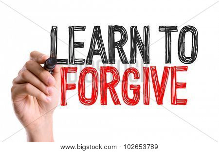 Hand with marker writing: Learn To Forgive