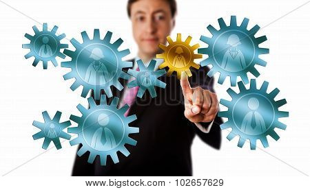 Consultant Picking A Worker Cog In A Gear Train