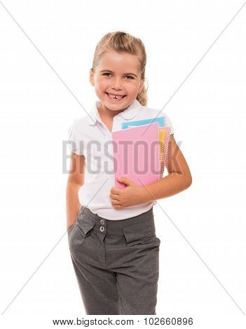 Little girl holding several notebooks and smiling