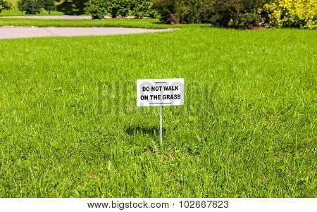 Notice Board On The Lawn With Text