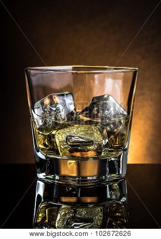 Glass Of Whiskey On Black Table With Reflection, Warm Atmosphere Dark Light