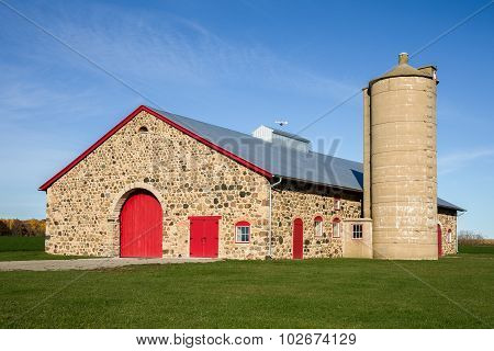 Retro Stone Barn With Bright Red Doors