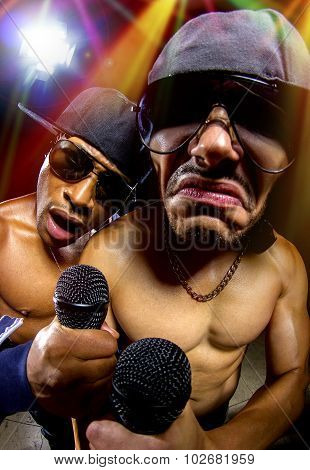 Rappers having a hip hop music concert with microphones poster