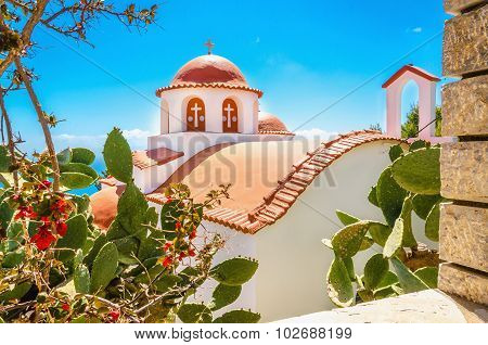 Typical Greek church with red roofing, Greece