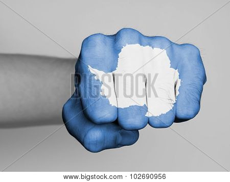 Very hairy knuckles from the fist of a man punching flag of Antarctica poster