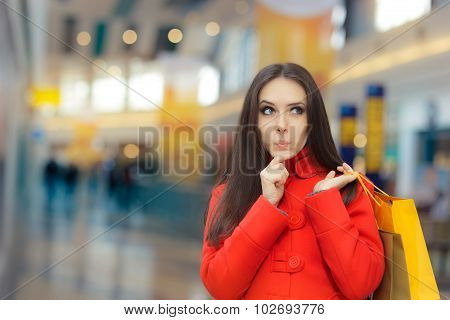 Curious Girl in a Red Coat Shopping in a Mall