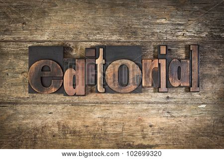 editorial, set with vintage letterpress printing blocks on wooden background