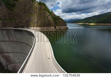Mountain Landscape With Dam And Lake