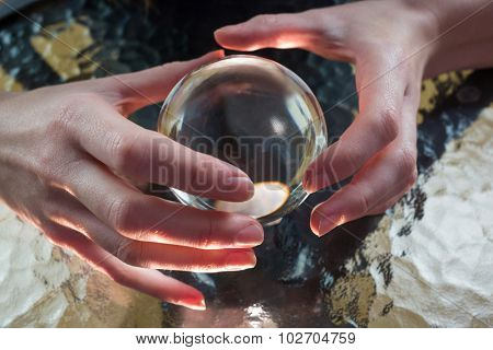 Fortune teller using crystal ball high angle view